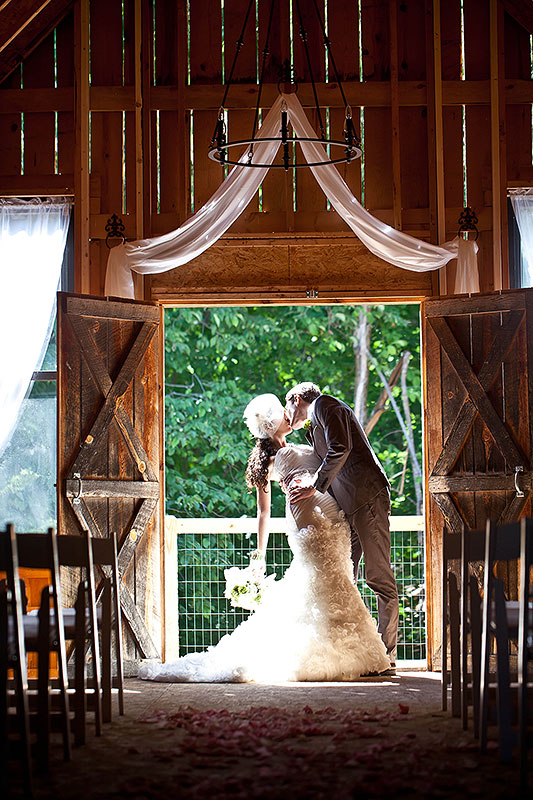 Wedding kiss at the entrance to The Barn